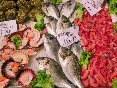 rialto: Venetian fish market - dorados and prawns. The Rialto fish market is located alongside the Grand Canal near the Rialto Bridge - Venice, Italy Stock Photo