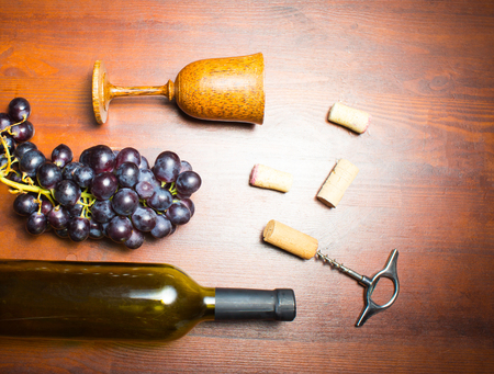 closed corks: The empty bottle of wine with corkscrews and glass of coconut on wooden background