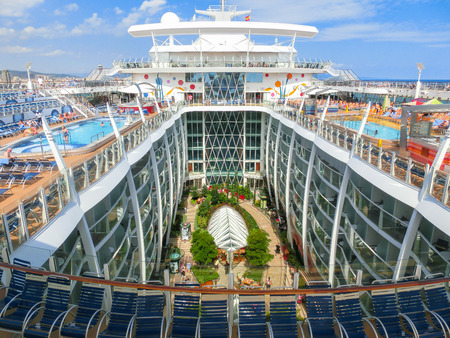 allure: Barselona, Spaine - September 06, 2015: Royal Caribbean, Allure of the Seas sailing from Barselona on September 6 2015. The second largest passenger ship constructed behind sister ship Oasis of the Seas. View of central park
