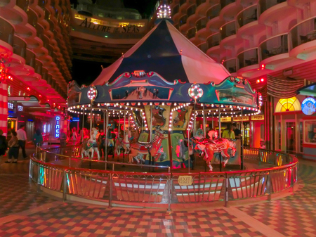 allure: Barselona, Spaine - September 10, 2015: Royal Caribbean, Allure of the Seas sailing from Barselona on September 6 2015. The second largest passenger ship constructed behind sister ship Oasis of the Seas. Passengers walking inside the ship. French carousel
