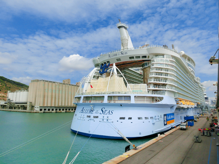 Barselona, Spaine - September 06, 2015: Royal Caribbean, Allure of the Seas is in port at startup in Barselona on September 6, 2015. The view from the stern of the ship Editorial