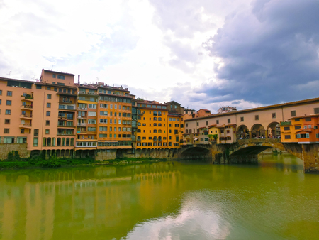 Ponte Vecchio bridge in Florence, Italy. Arno River. Tuscany. Rainy day