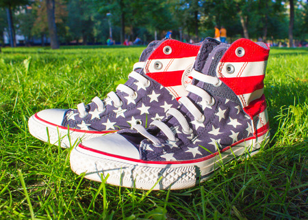 converse: Dnipropetrovsk, Ukraine - August, 21 2016: All Star Converse sneakers on green grass in park
