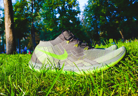 nike: Dnipropetrovsk, Ukraine - August, 21 2016: New style nike shoes on green grass in park - illustrative editorial
