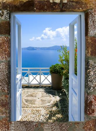 Beautiful sea view from the balcony. Oia town, Santorini island, Greece. Stock Photo
