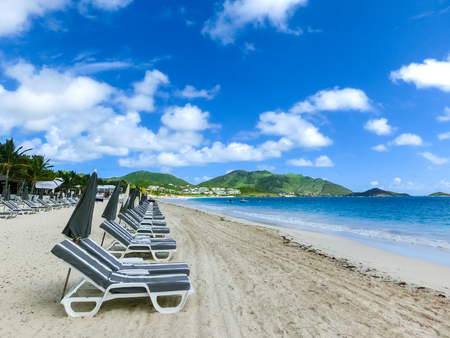 The chairs and umbrellas on Caribbean tropical beach Stock Photo