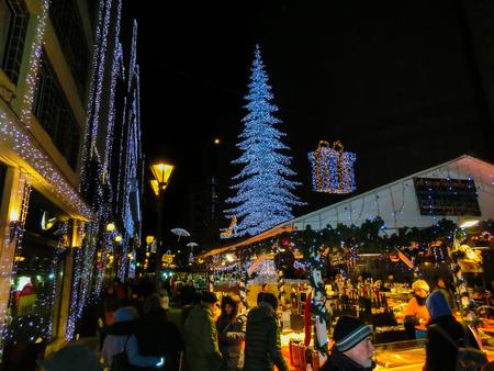 Budapest, Hungary - December 30, 2015: Tourists enjoy the Christmas market in centre of Budapest, Hungary. Редакционное
