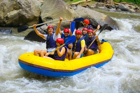 river rafting: Bali, Indonesia - April 11, 2012: Rafting in the canyon on Balis mountain river Ayung at Indonesia