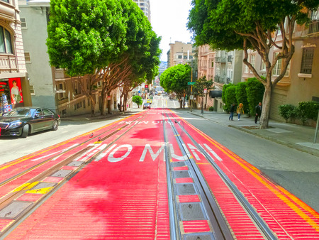 streetlife: San Francisco, California, United States of America - May 04, 2016: typical San Francisco street with cable car tracks, California
