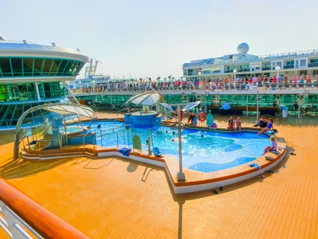 seas: Venice, Italy - June 06, 2015: Cruise ship Splendour of the Seas of Royal Caribbean International moored in Venice, Italy on 06, 2015 against another cuise ship Norwegian Jade