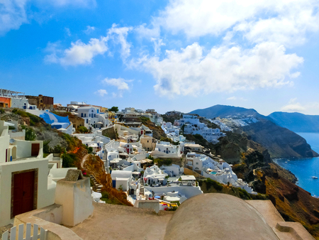 fira: View to the sea from Oia village of Santorini island in Greece