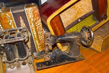 primus: The dump of stuff - old sewing machine Stock Photo
