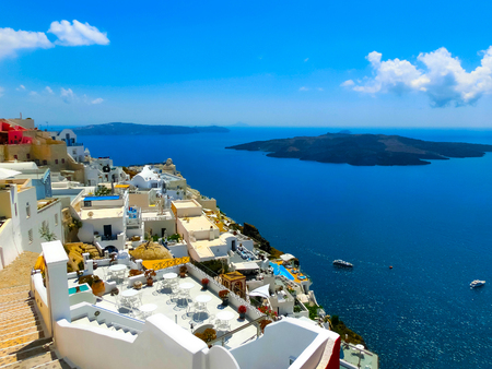 View to the sea from Fira the most beautiful village of Santorini island in Greece 免版税图像