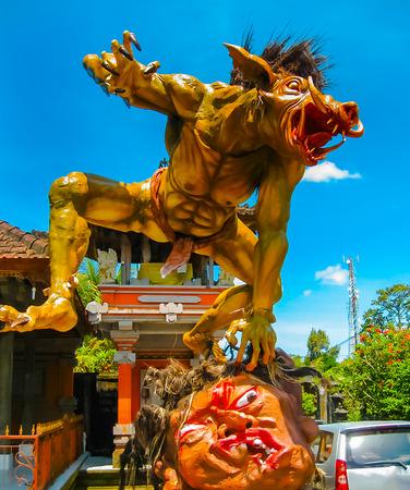 Balinese monster Ogoh on blue background Stock Photo