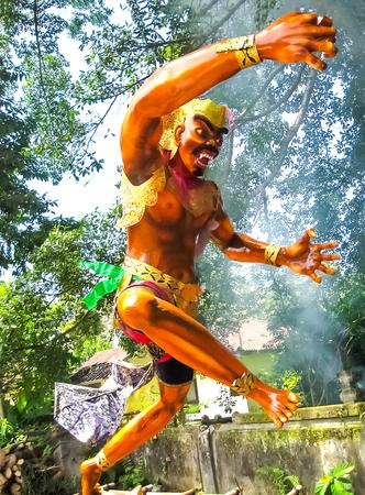 Ubud, Indonesia - April 17, 2012: Balinese monster Ogoh on blue background