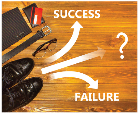 Future concept with business male shoes and road markings Stock Photo