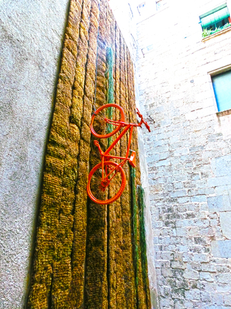 Pals, Girona, Spain - September 15, 2015: The wall with installation at Old town of Pals in Girona, Catalonia, Spain.