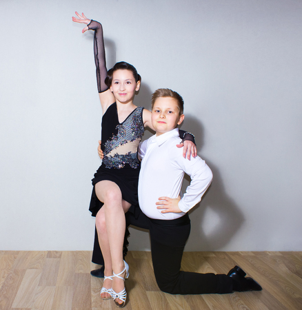 The young boy and girl posing at dance studio Stock Photo