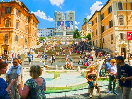 Rome, Italy - September 10, 2015: Spanish steps and Ugly Boat fountain surronded by hundreds of tourists