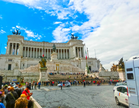 Rome, Italy - May 03, 2014: Tourists going at Piazza Venezia and Victor Emmanuel II Monument in Rome, Italy on June 01, 2016