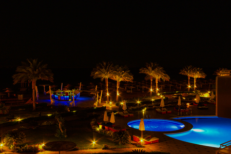 Sheikh: Sharm El Sheikh, Egypt - April 7, 2017: Evening view of swimming pool at luxury hotel Barcelo Tiran Sharm 5 stars at night