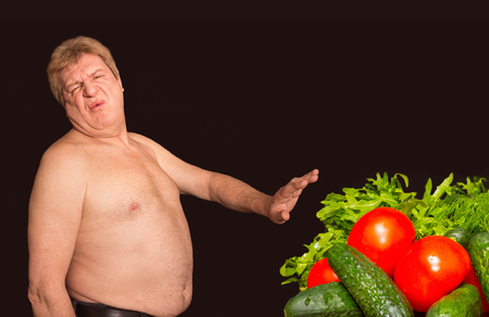denying: The diet concept - overweight and fat man denying healthy food Stock Photo