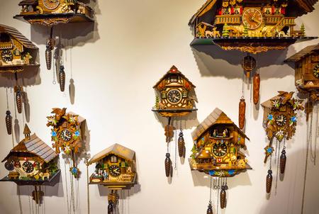 pendulum: The lot of swiss wooden clocks Stock Photo