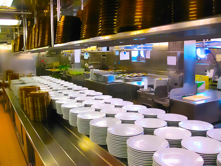 The kitchen with plates ready for serving dinner on a cruise ship