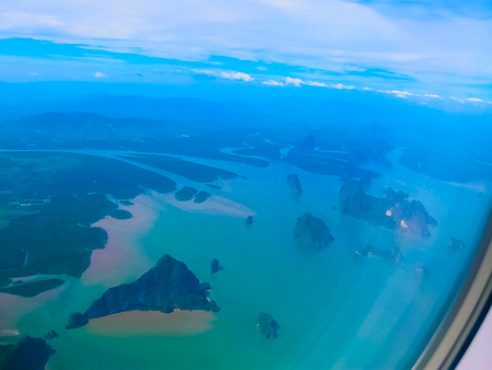 The sea view from airplane porthole window