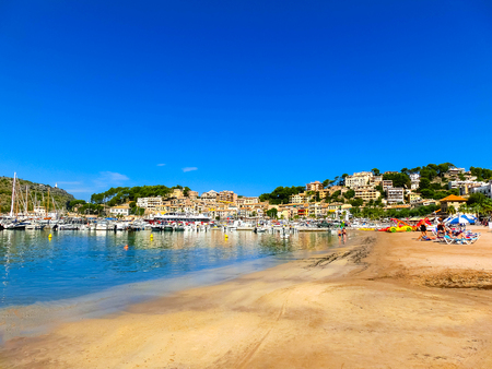 mallorca: Palma de Mallorca, Spain - September 07, 2015: View of the beach of Port de Soller with people lying on sand, Soller, Balearic islands, Spain.