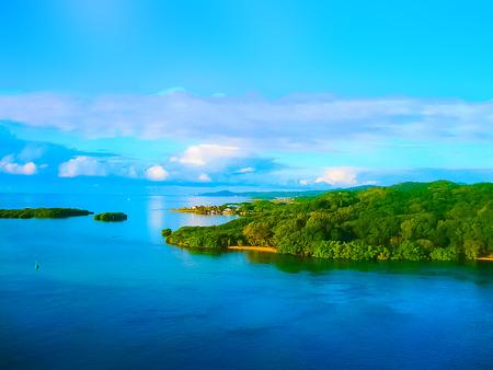 An aerial view of a tropical beach in Roatan Honduras
