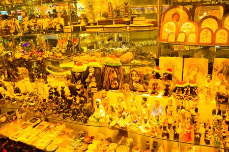 Sharm El Sheikh, Egypt - April 13, 2017: Alabaster vase and statuette in Egyptian souvenir shop