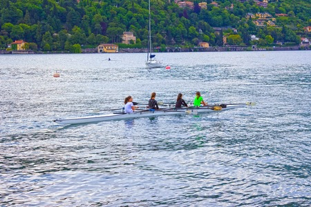Como, Italy - May 03, 2017: Group of people canoeing during leisure time