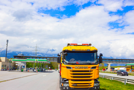 hauler: Salzburger Land, Austria - MAY 3, 2017: Yellow Scania truck is parked near the gas station