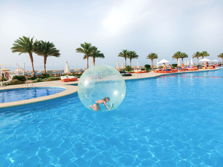 Sharm El Sheikh, Egypt - April 09, 2017: Little girl in an inflatable balloon, having fun on the water.