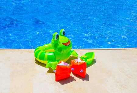 the furlough: Colorful inflatable ball against blue swimming pool
