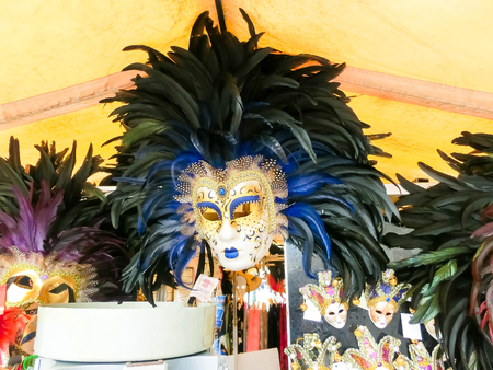 Venice, Italy - May 04, 2017: Vendors stands - profitable and popular form of sales traditional souvenirs and gifts like masks, magnets, clothes and travel guides to tourists visiting Venice.