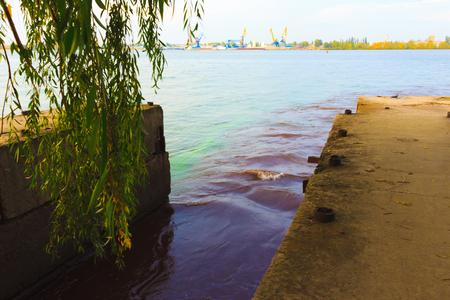 contaminacion del agua: riverscape of large drainage steel pipe background.
