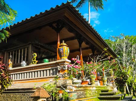 Bali, Indonesia - April 11, 2012: View of wooden furniture, painting, a work art at Tanah Merah Resort Editorial