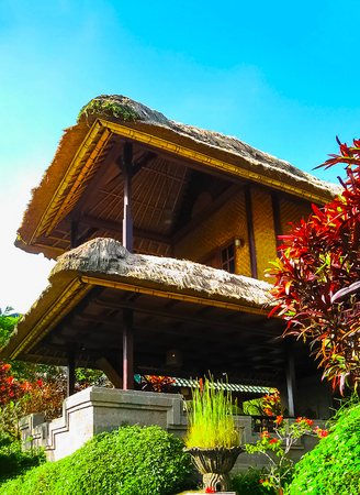 Bali, Indonesia - April 11, 2012: View of traditional house at Tanah Merah Resort Editorial