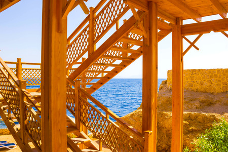 monte sinai: The wooden staircase in the water at the beach at the reef in Sharm el Sheikh, Egypt