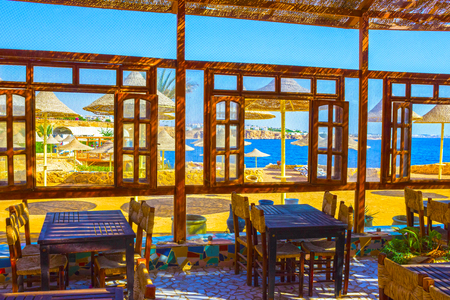 Sharm El Sheikh, Egypt - September 24, 2017: Outdoor restaurant and beach at the luxury hotel, Sharm el Sheikh, Egypt