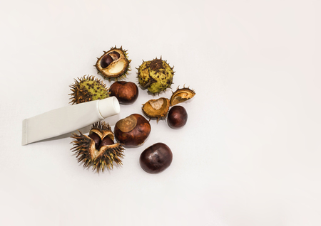 medicine cream from horse chestnuts on white wooden table