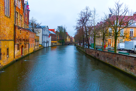The evening shot of historic medieval buildings along a canal in Bruges, Belgium Stock Photo