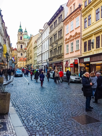 Prague, Czech Republic - December 31, 2017: The people going near houses of old architecture in Old Town