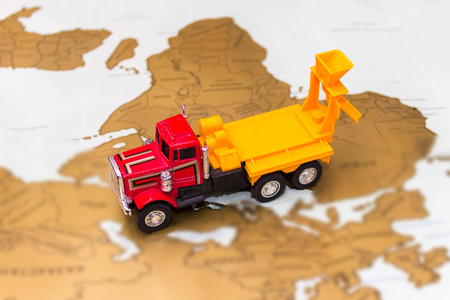 transportation and travel concept - truck on the map Stock Photo