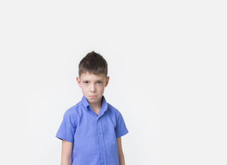 Handsome eight year old boy posing in studio over white background. Stock Photo