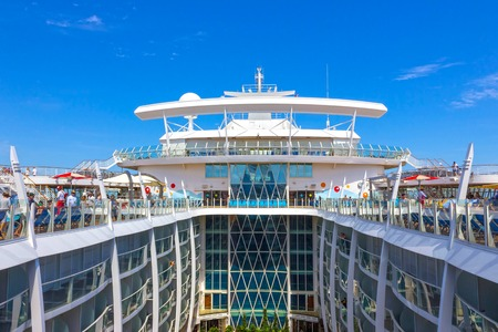 Fort Lauderdale, USA - 30 April, 2018: The upper deck with swimming pools at cruise liner or ship Oasis of the Seas by Royal Caribbean