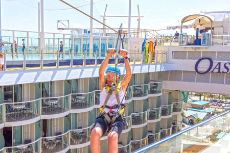 Ft. Lauderdale, USA - 30 April, 2018: The passenger flying at zip line at cruise liner or ship Oasis of the Seas by Royal Caribbean Editorial