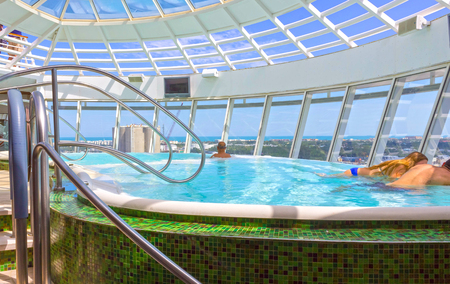 Fort Lauderdale, USA - 30 April, 2018: The people rest in the Jacuzzi pool at upper deck at cruise liner or ship Oasis of the Seas by Royal Caribbean